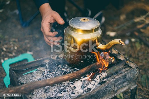 Kettle pot boiling on campfire