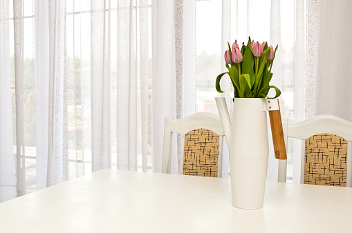 Kettle shaped flowervase on the table, home decoration