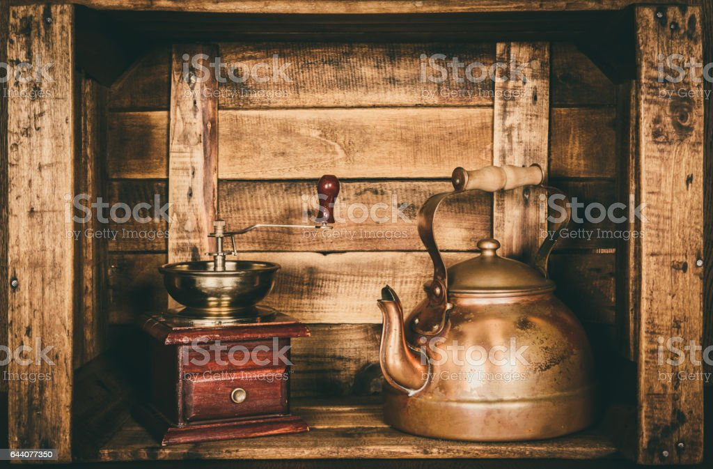Kettle teapot retro vintage old, inside a wooden box, style window stock photo