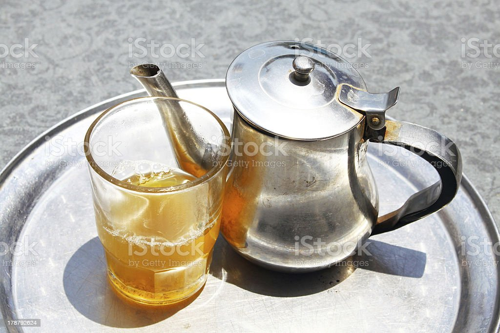 Kettle with tea glass on a tray royalty-free stock photo