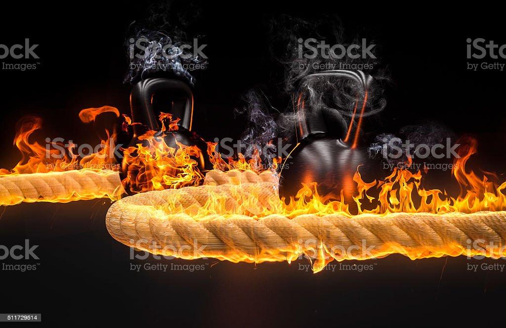 kettlebel und Seilspringen in Feuer – Foto