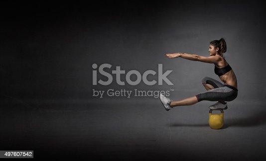 istock kettlebell balance demonstration 497607542