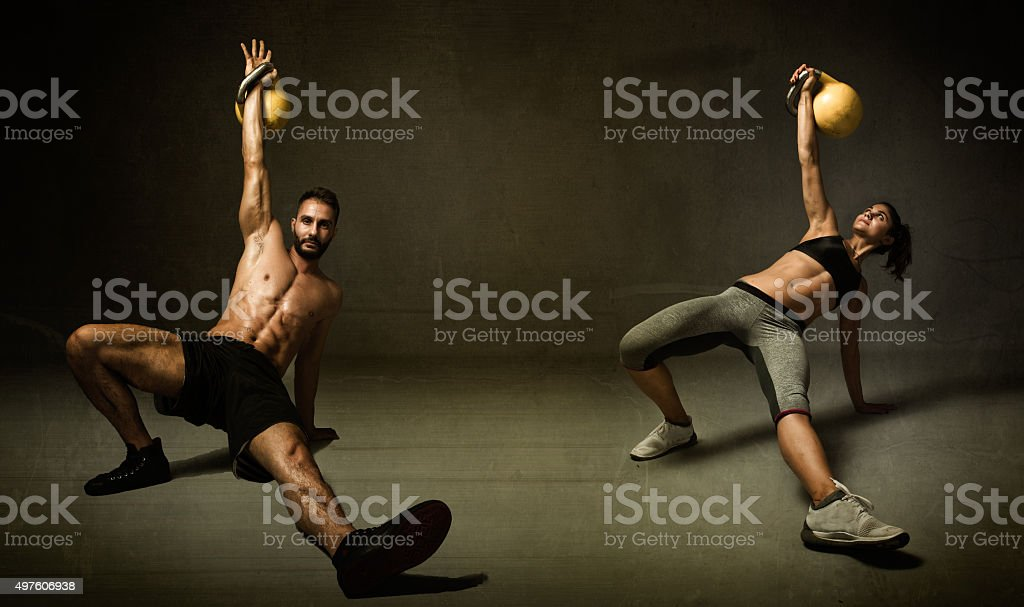 kettlebell excercise for two persons stock photo
