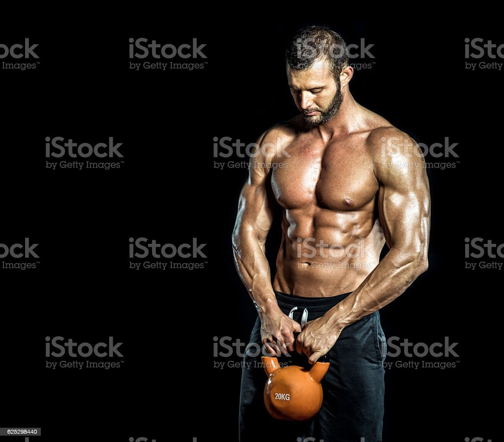 Kettlebell in hands stock photo