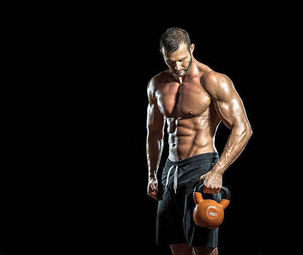 kettlebell in hands - testosterone stock pictures, royalty-free photos & images