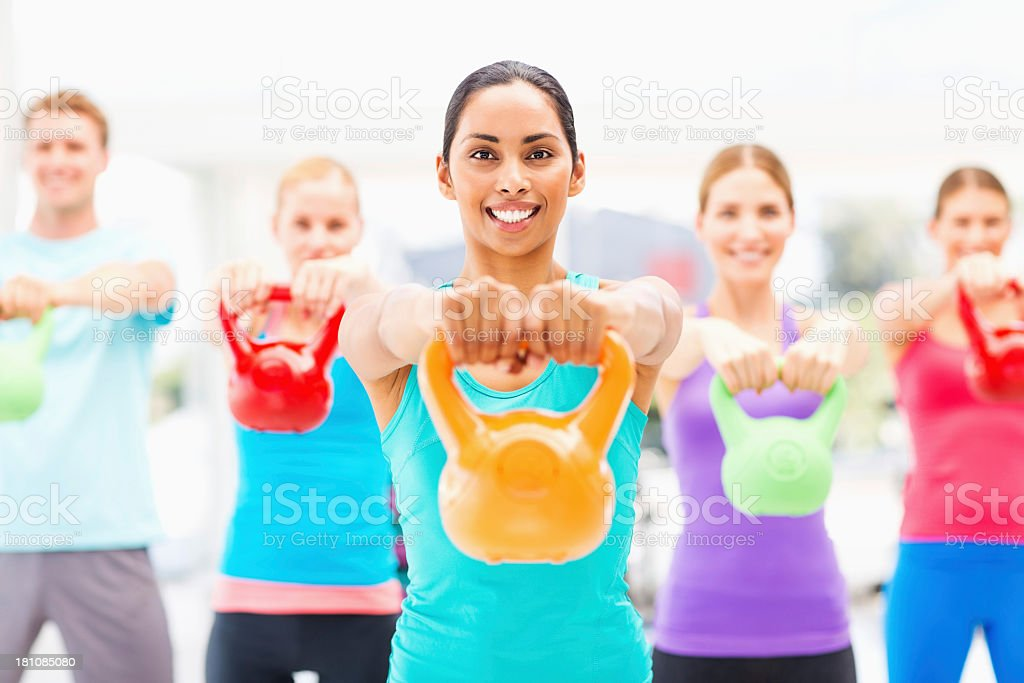 Kettlebell Instructor With Class Weight Lifting In Gym royalty-free stock photo