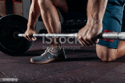 944655208 istock photo Kettlebell training in gym. Athlete doing workout 1075070010