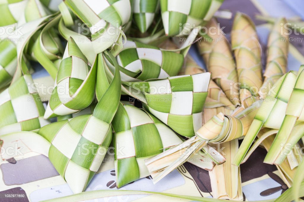 Ketupat, dumpling made of woven palm leaf stuffed with rice stock photo