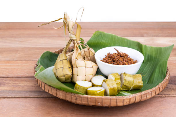 ketupat, lemang, served with serunding, popular malay delicacies during hari raya celebration - ketupat stock pictures, royalty-free photos & images