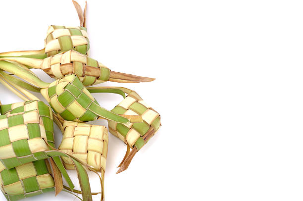 ketupat (rice dumpling) on white background - ketupat stock pictures, royalty-free photos & images