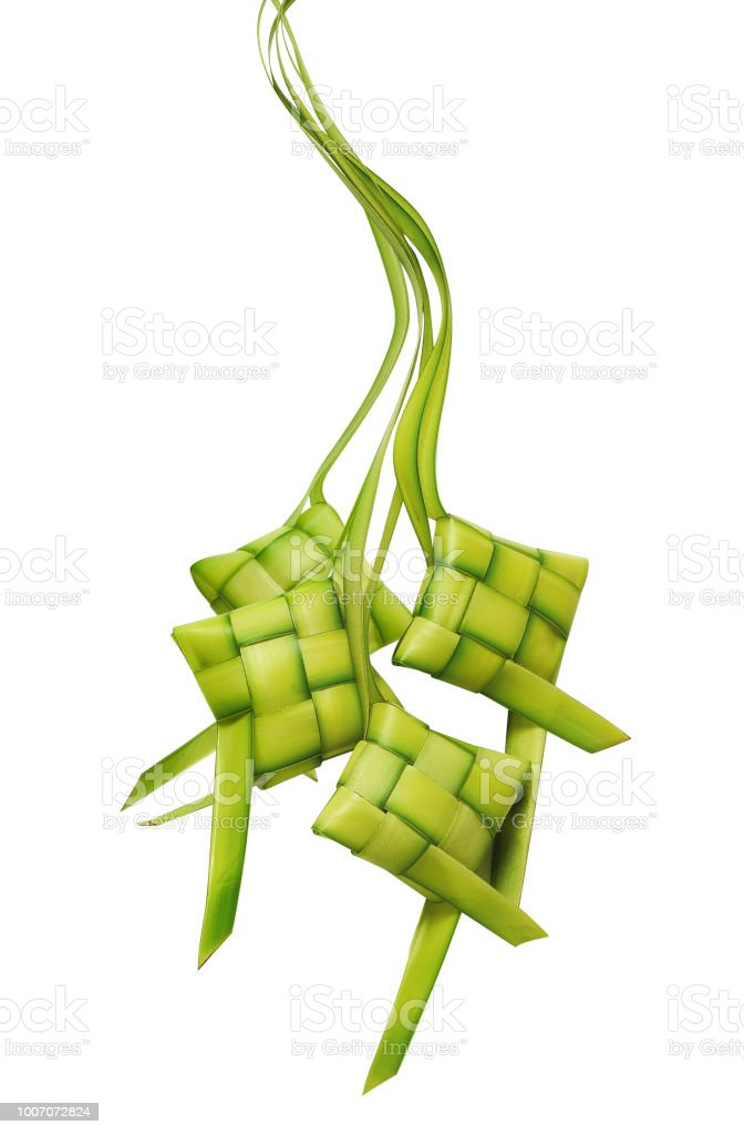 Ketupat or rice dumpling is a local delicacy during the festive season. Ketupats, a natural rice casing made from young coconut leaves for cooking rice on a white background stock photo