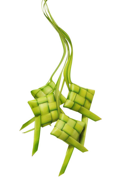 ketupat or rice dumpling is a local delicacy during the festive season. ketupats, a natural rice casing made from young coconut leaves for cooking rice on a white background - ketupat stock pictures, royalty-free photos & images
