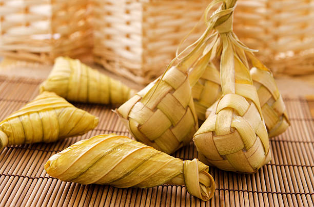ketupat or rice dumpling. - ketupat stock pictures, royalty-free photos & images