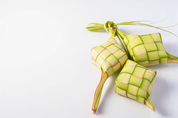 ketupat (rice dumpling on white background) - ketupat stock pictures, royalty-free photos & images