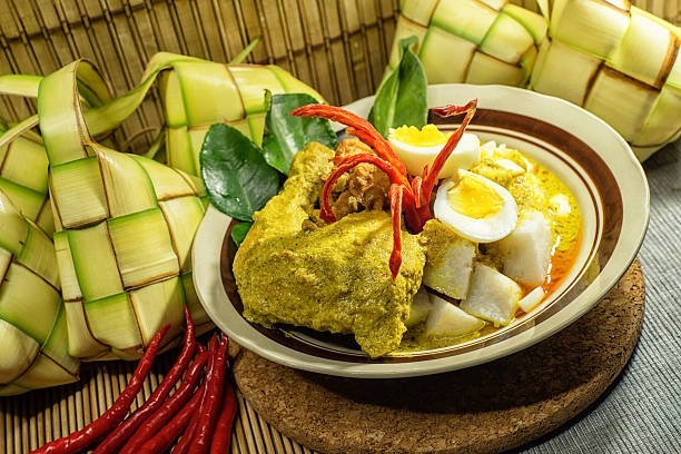 ketupat sayur with ayam opor - ketupat stock pictures, royalty-free photos & images