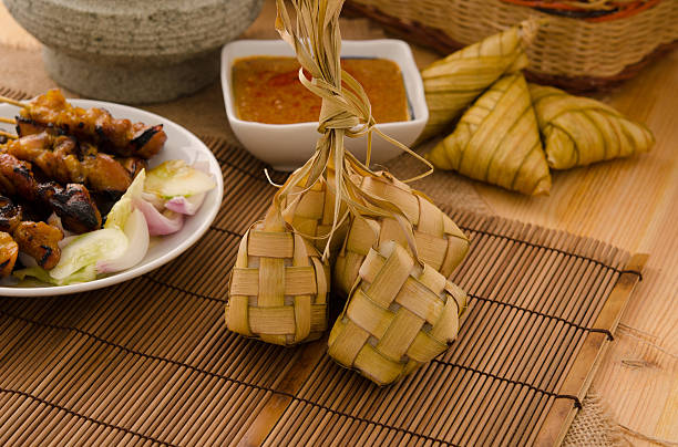 ketupat: south east asian rice cakes bundle, often prepared for - ketupat stock pictures, royalty-free photos & images
