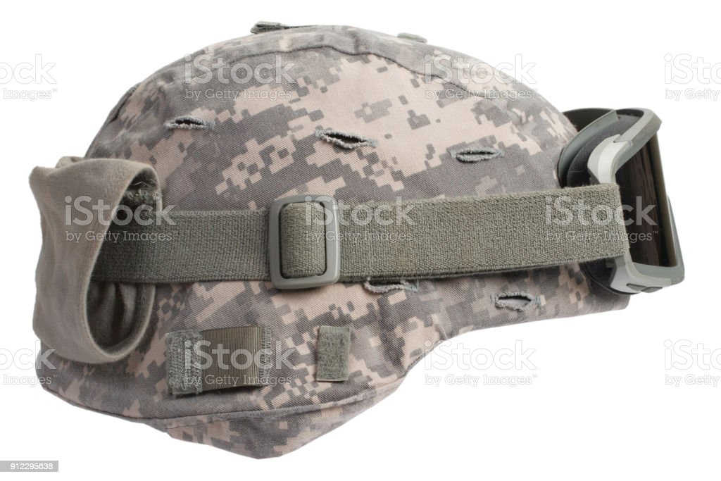 kevlar helmet with camouflage cover and protective goggles stock photo