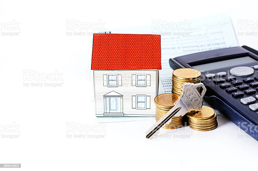 key and coins stack with calculator and paper house with saving passbook stock photo