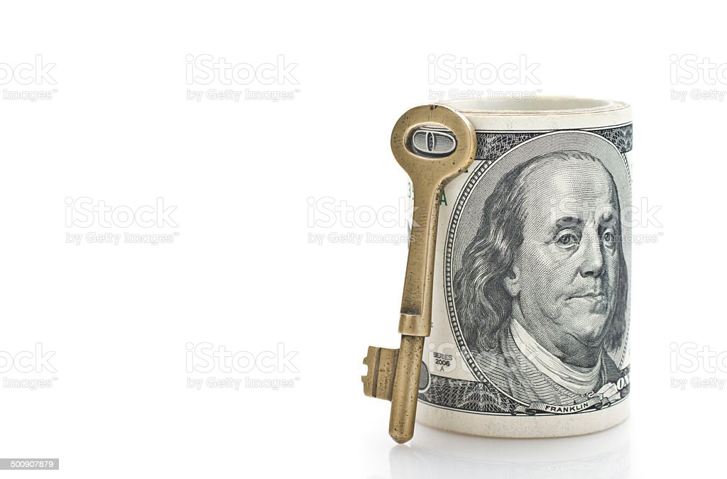 Key and dollar stand on white stock photo