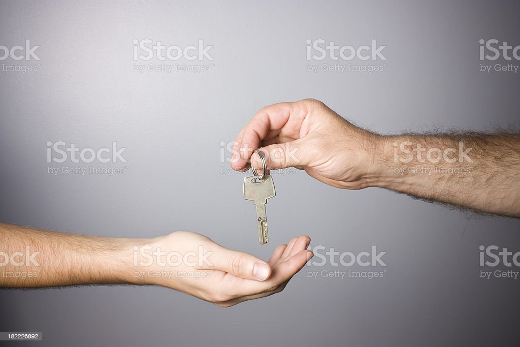 Key and hands royalty-free stock photo