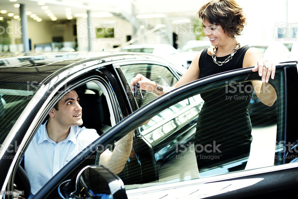 Key being given royalty-free stock photo