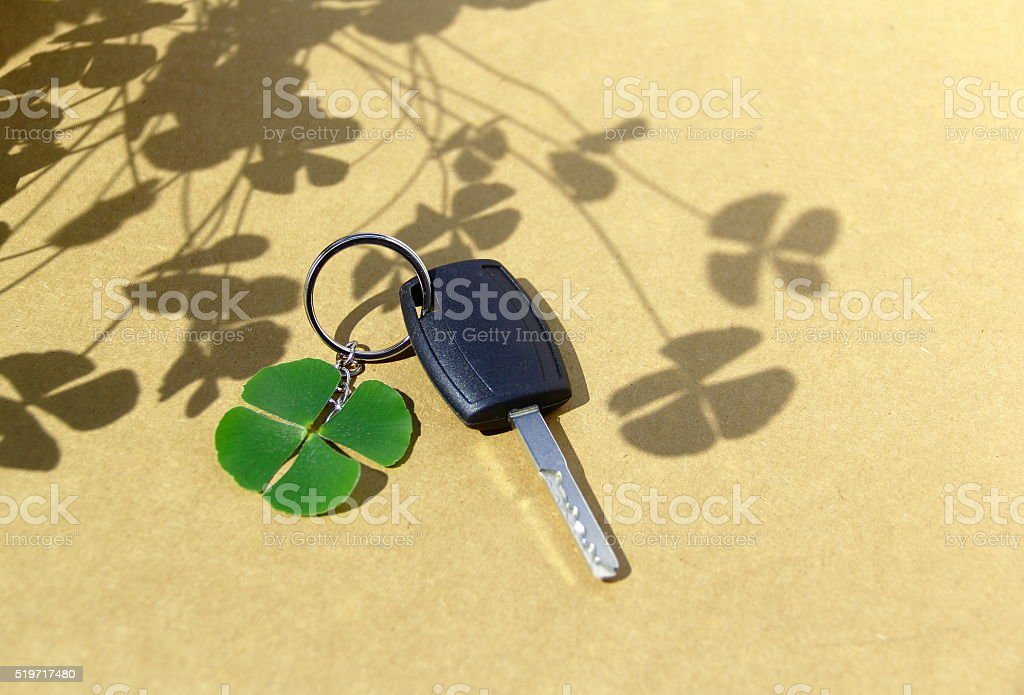 Key car and clover leaf. stock photo