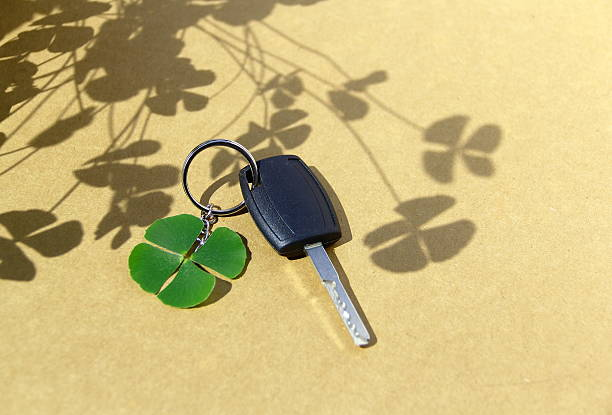 Key car and clover leaf. stock photo