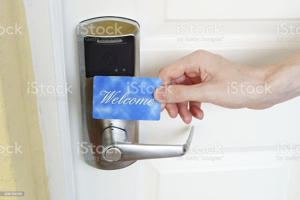 Key card held over digital door lock stock photo