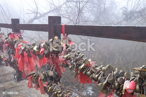 istock Key chain on bridge for lovers at Zhangjiajie National 927489100