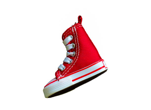Key chain with mini red basketball shoe on white background stock photo