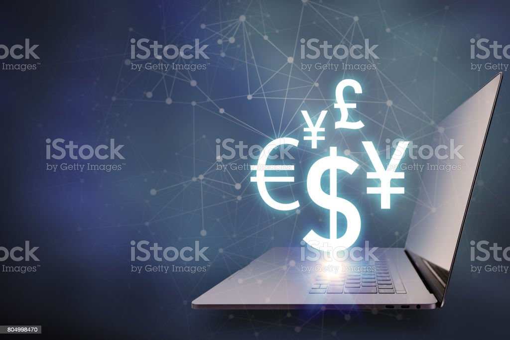 key currency symbols floating on laptop PC, financial technology concept stock photo