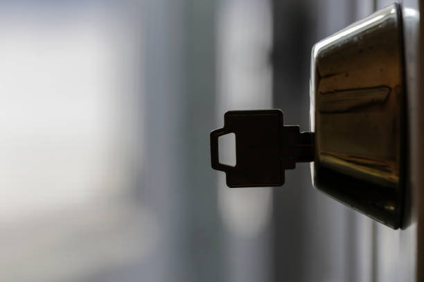 A Key in a Dead Bold Lock A Key in a Dead Bold Lock locksmith stock pictures, royalty-free photos & images