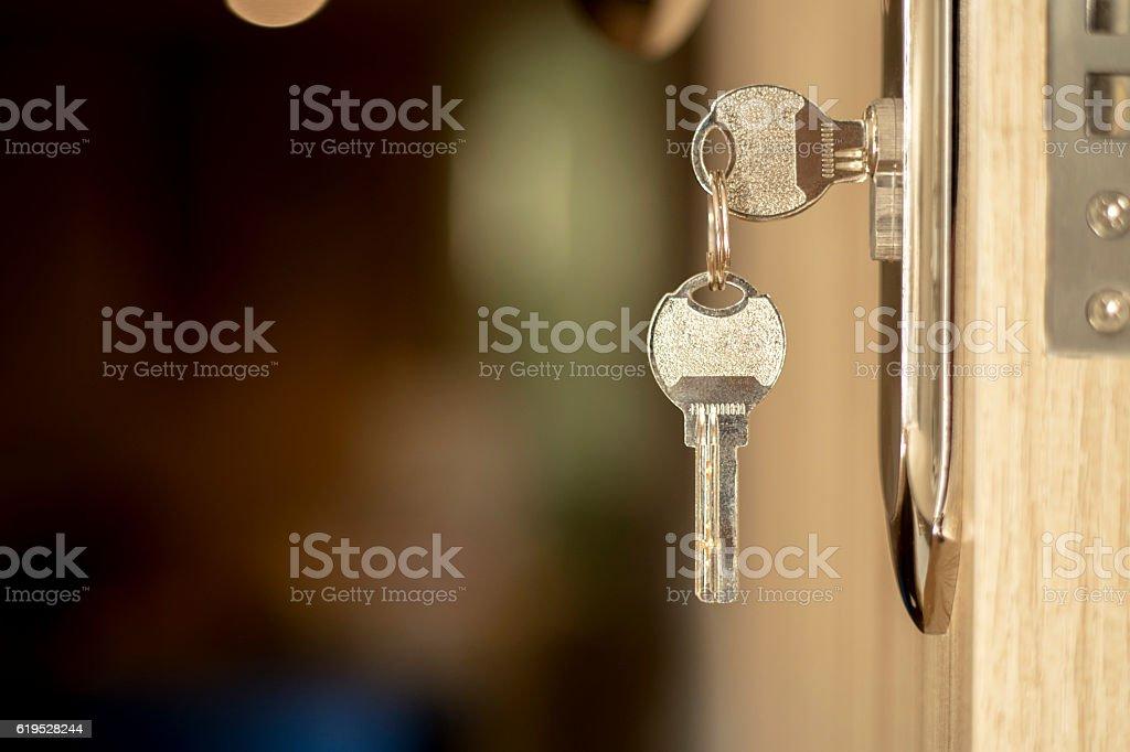 key in door lock stock photo