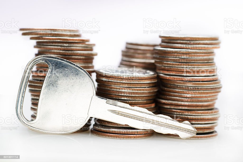 Key in Front of Stacks of Money stock photo