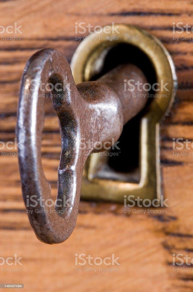 Key in Keyhole stock photo