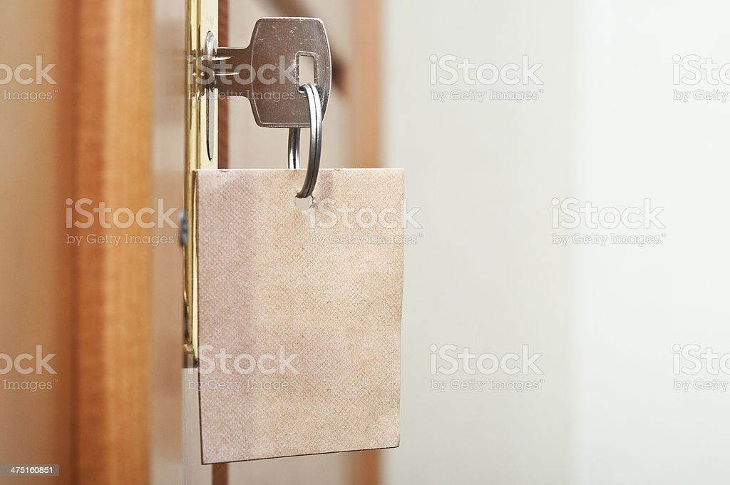key in keyhole with blank label stock photo
