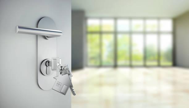 key in the door lock of open modern door - locatario foto e immagini stock