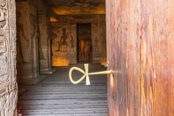 A key in the door of the Small Temple at Abu Simbel in the shape of an Ankh, an ancient Egyptian hieroglyph representing life stock photo