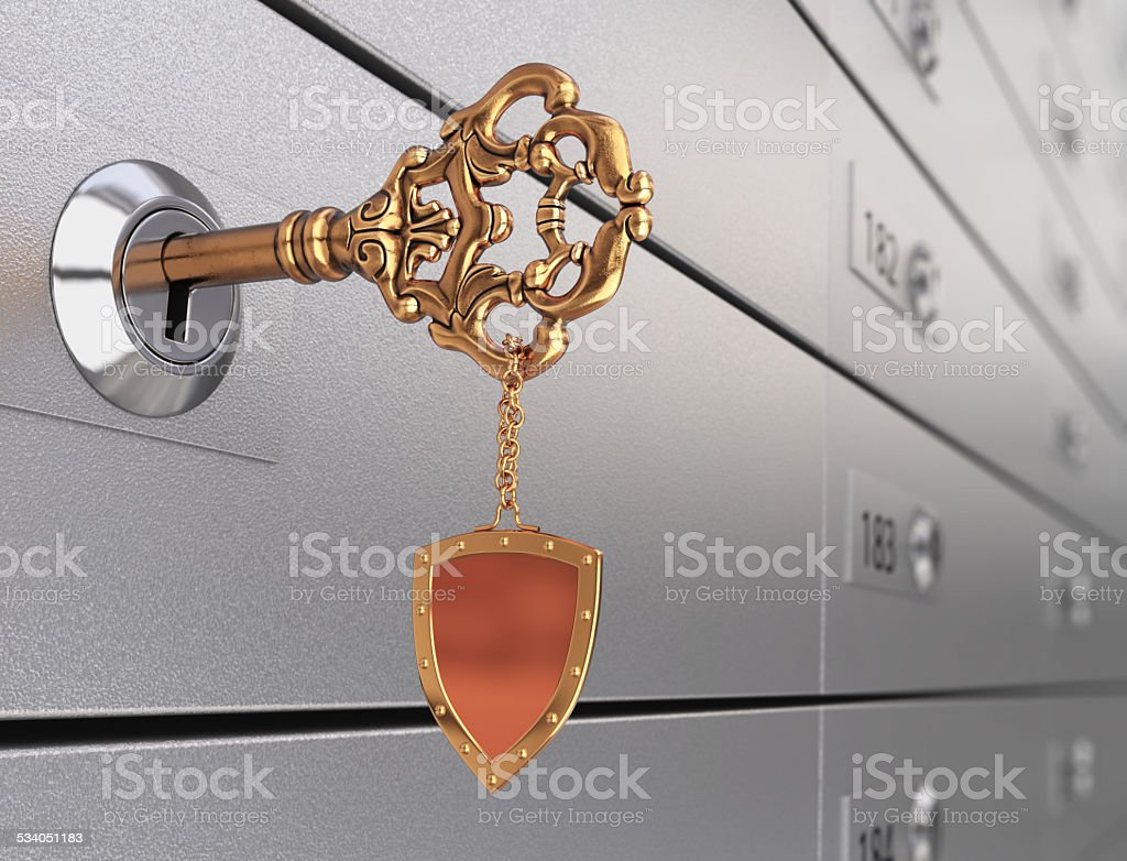Key in the safe deposit box stock photo