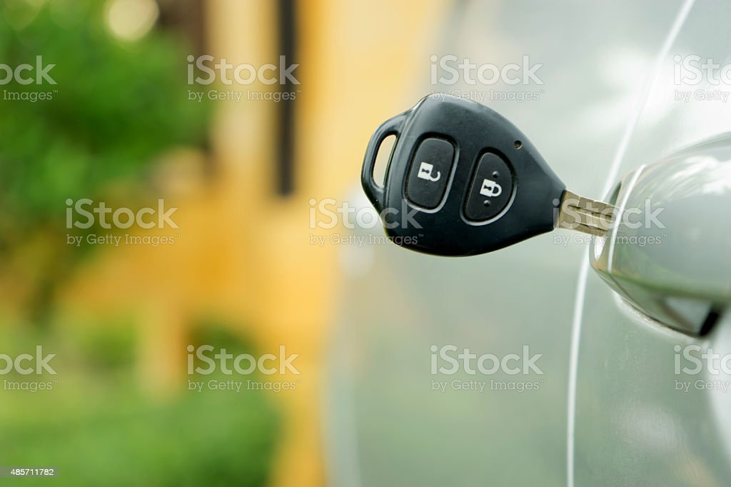 key is plugged into the car door. stock photo
