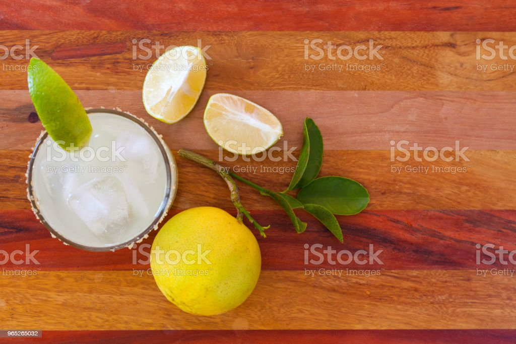 Key lime margarita garnished with fresh lime in a glass bar table. view from above royalty-free stock photo