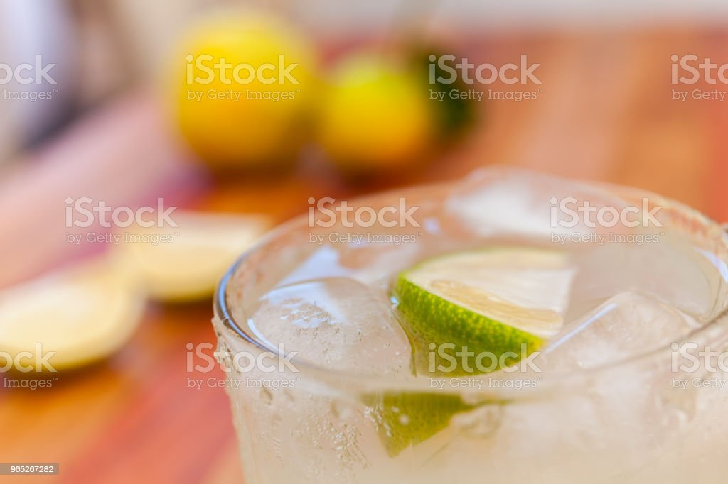 Key lime margarita garnished with fresh lime in a glass zbiór zdjęć royalty-free