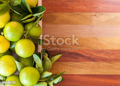Key Lime Or Mexican Lime In A Wooden Box On Floor One Of Main Ingredient Thai Food And Traditional Pie Horizontal Stock Photo & More Pictures of Acid