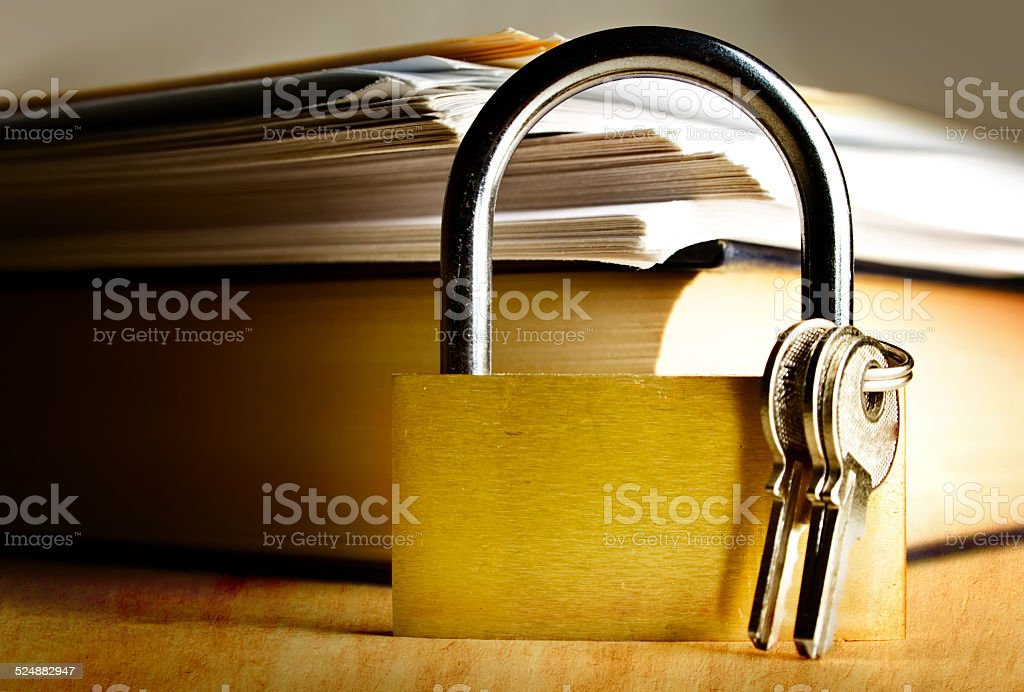 Key lock on stained paper background stock photo