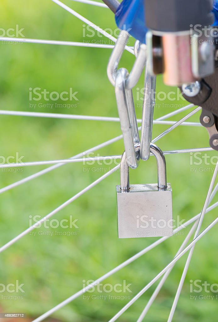 Key lock with chain on wheel bicycle royalty-free stock photo