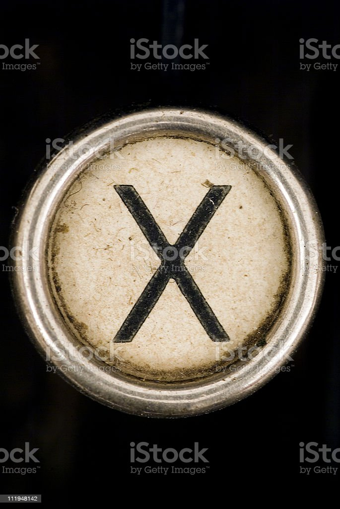 X key of a full alphabet from grungey typewriter royalty-free stock photo