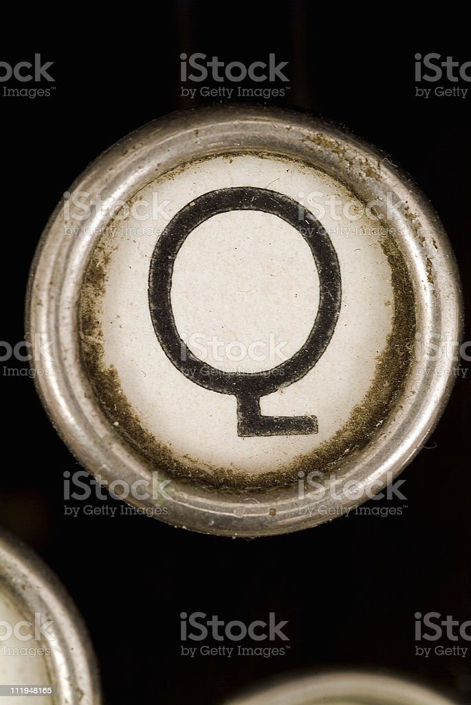 Q key of a full alphabet from grungey typewriter royalty-free stock photo