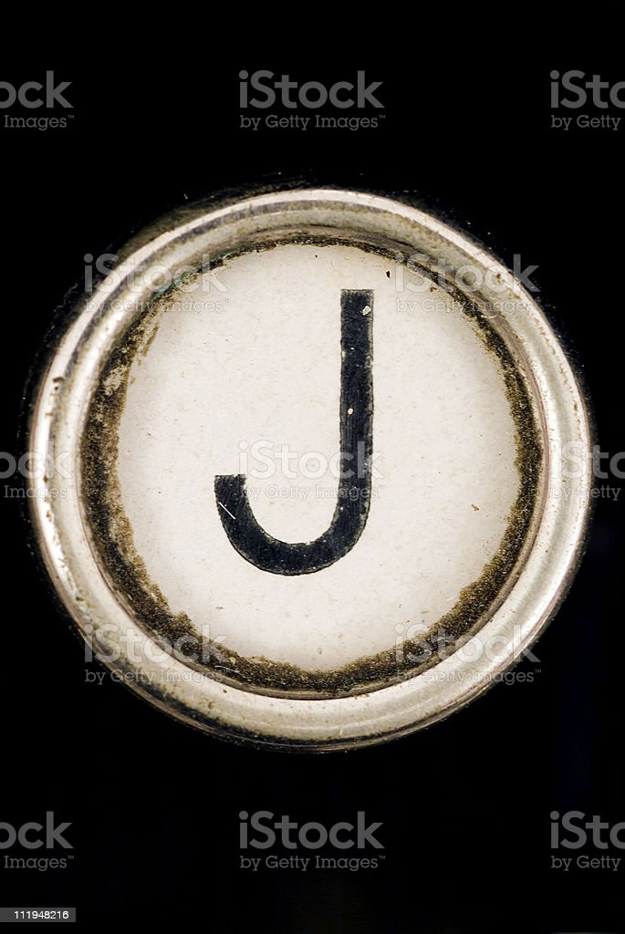 J key of a full alphabet from grungey typewriter stock photo