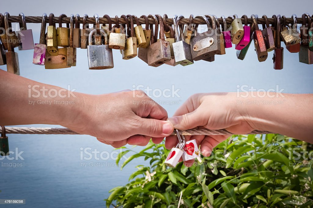 key of heart love with hand woman and man stock photo