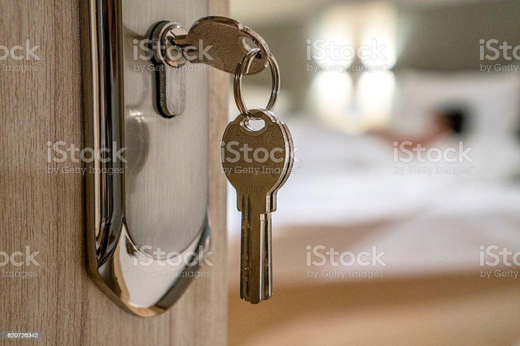 key on bedroom door stock photo
